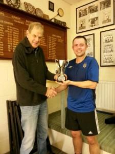 Tony Dixon awards the Simon Storey Handicap Trophy to DAve Barber